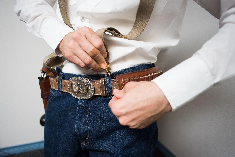 7 Groom fastening suspenders.jpg