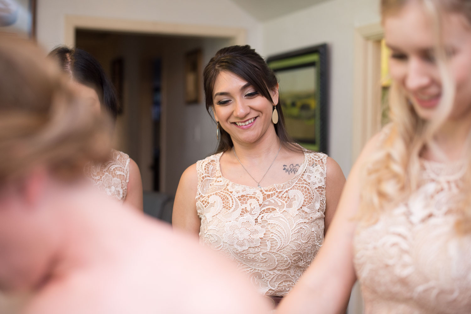 15 brittney's bridesmaids watch her as she gets ready.jpg