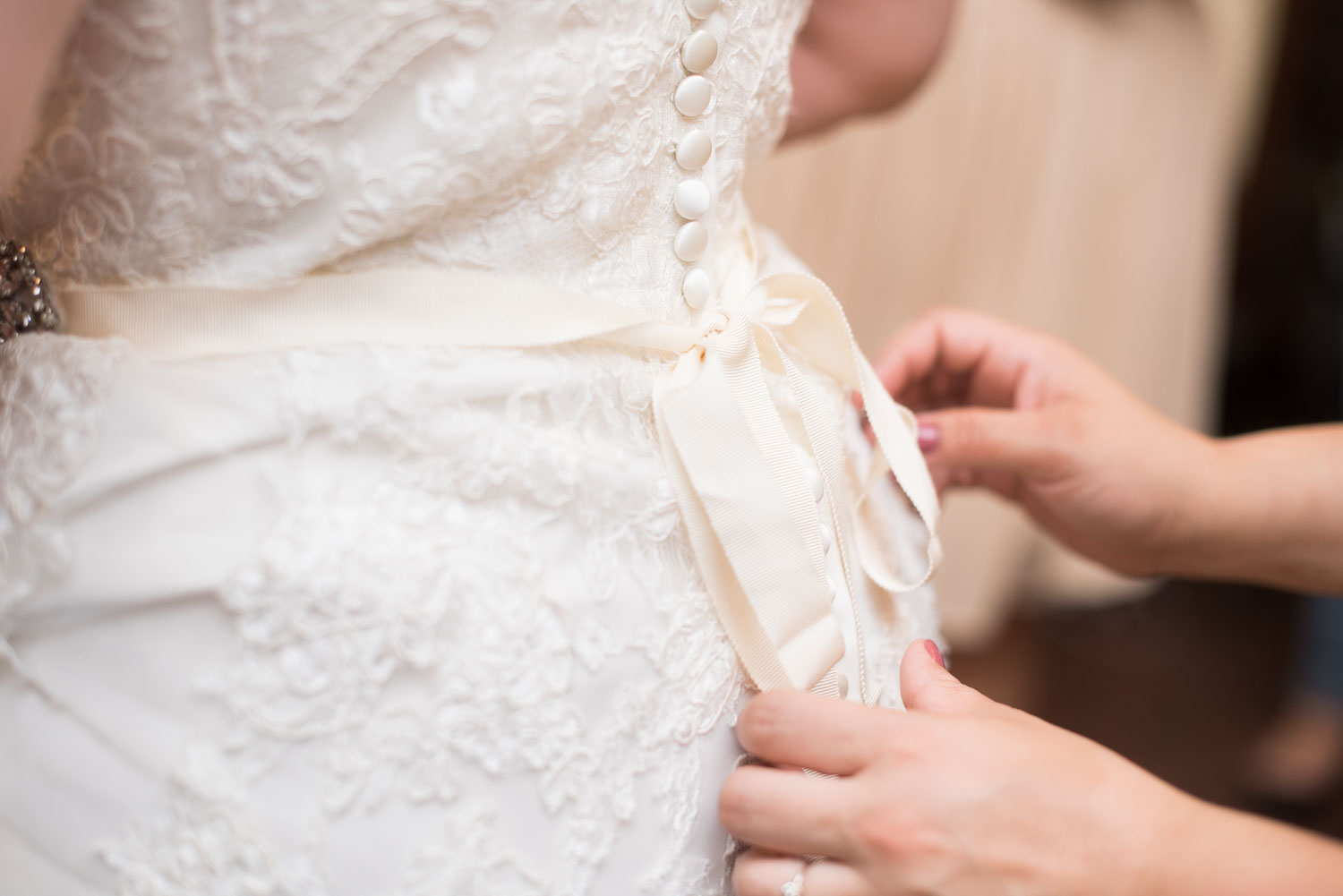 16 the bow on brittney's wedding dress is tied.jpg