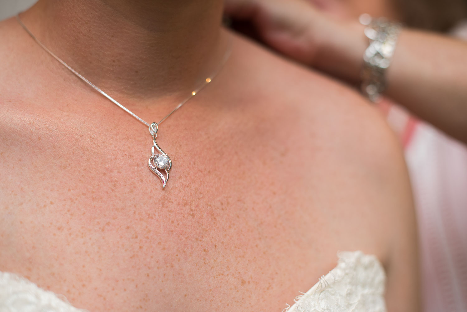 18 Mother of the bride helps put on the necklace she purchased for brittney as a wedding day gift.jpg