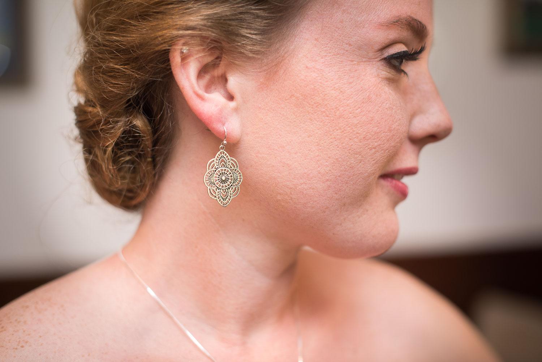 19 brittney puts on her wedding day earrings.jpg