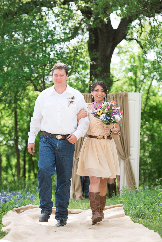 29. Bridesmaid is ushered down aisle by groomsman.jpg