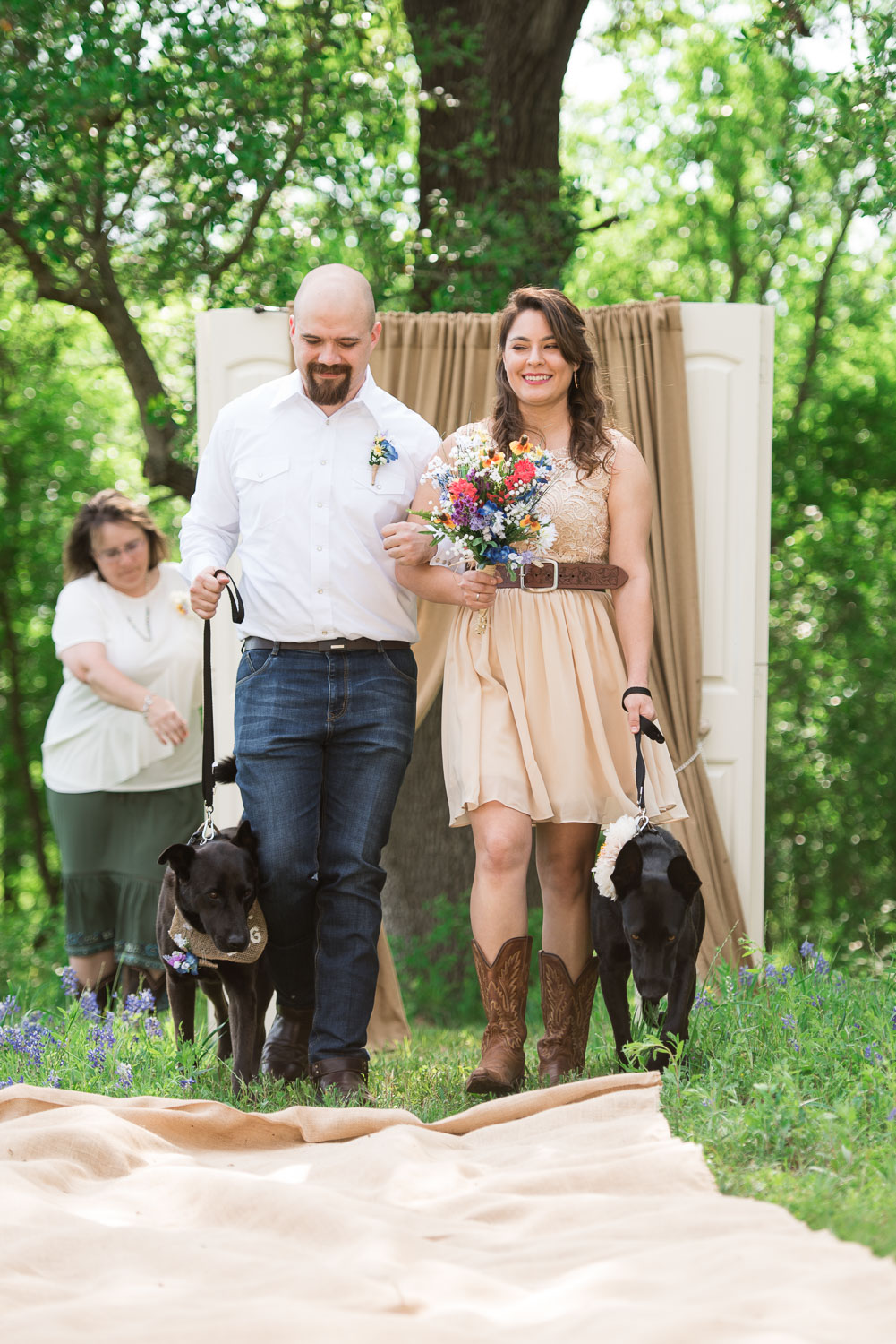 31 Best man and Maid of Honor walk the dogs down the aisle at this Texas Farmland wedding.jpg