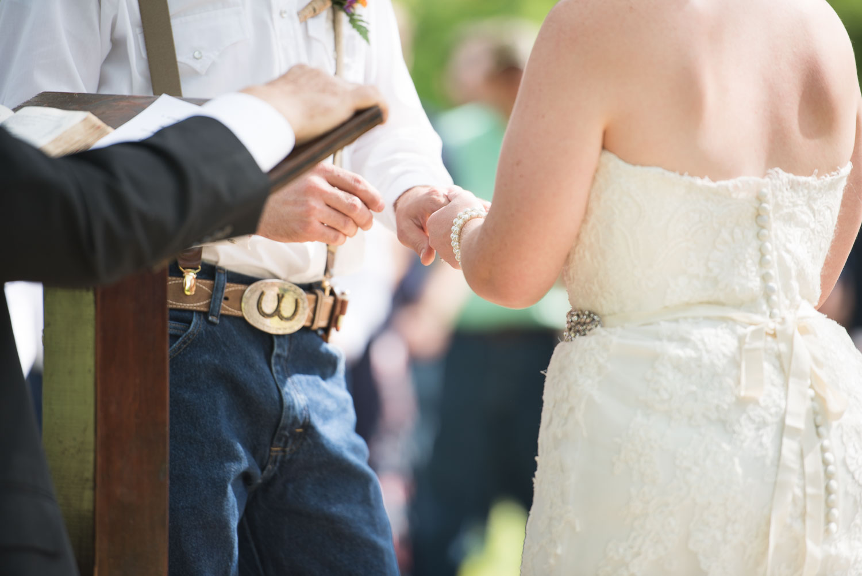 46 Bride and groom exchange wedding bands.jpg