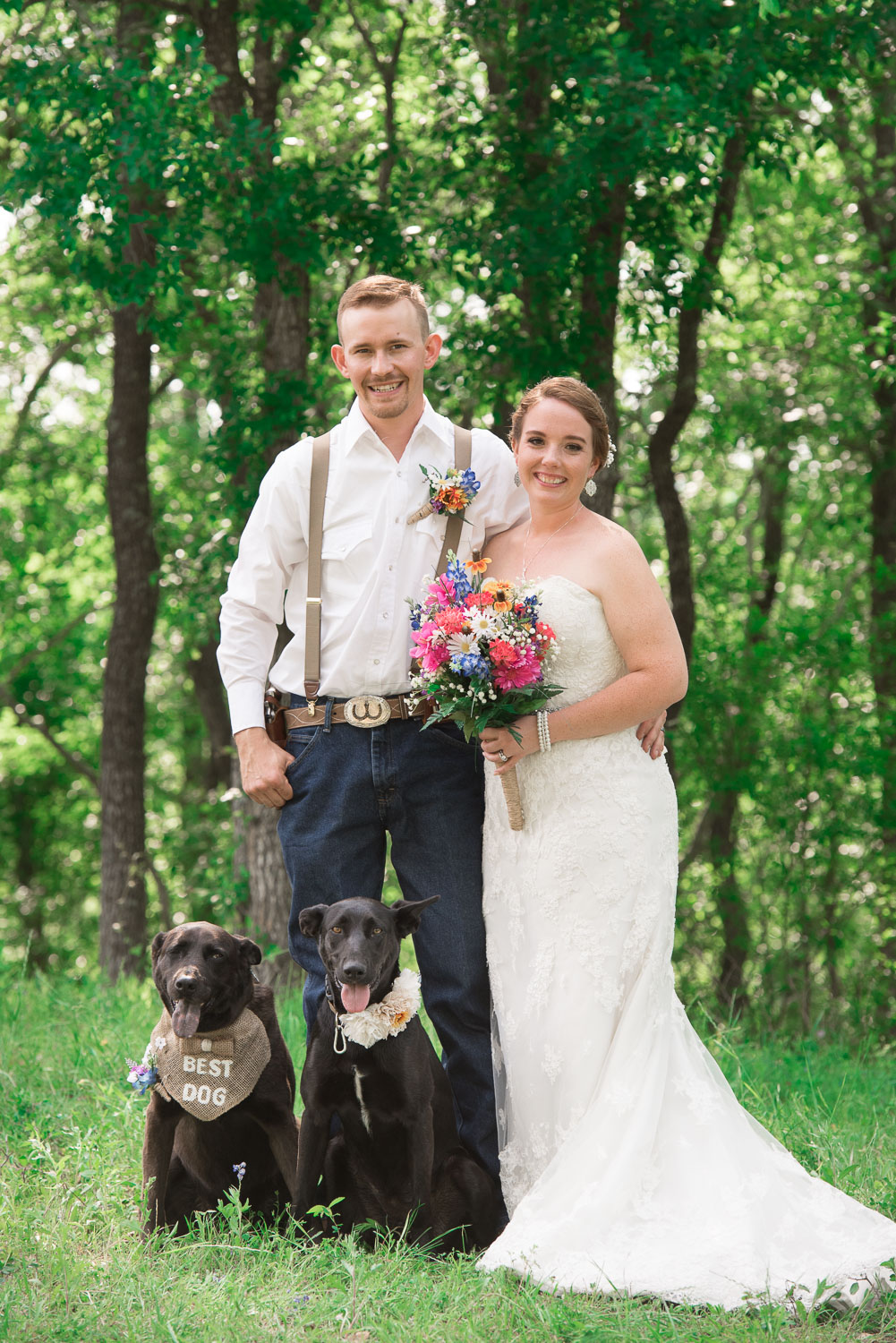 56 Bride and groom with their dogs during bridal portraits.jpg