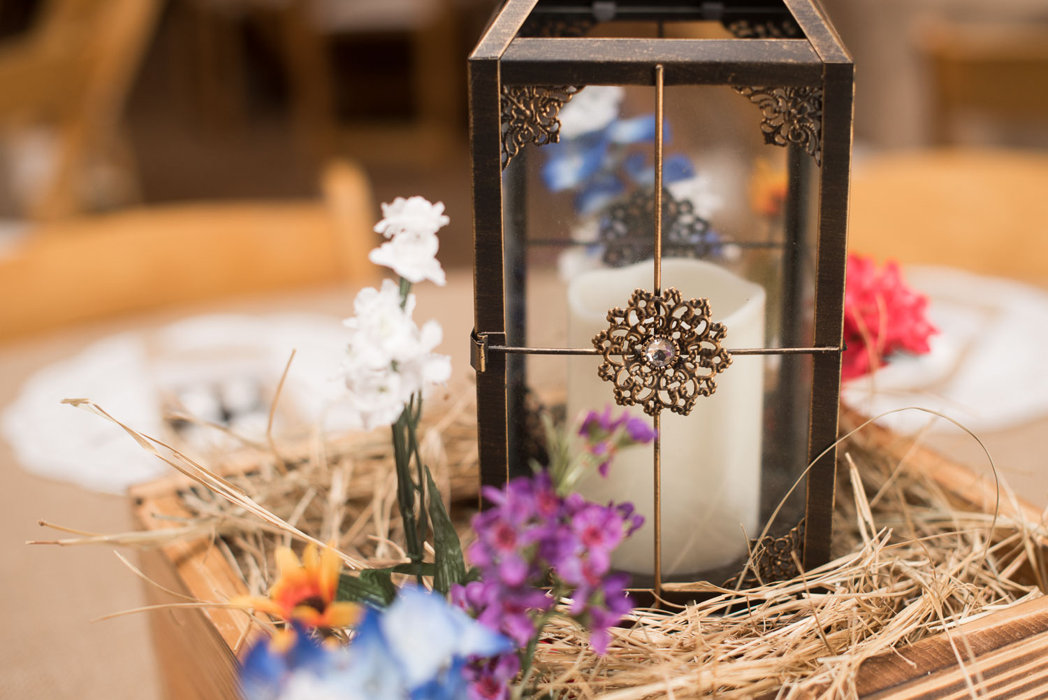 60 Reception Centerpieces lantern hay and wood boxes on burlap with wildflowers.jpg