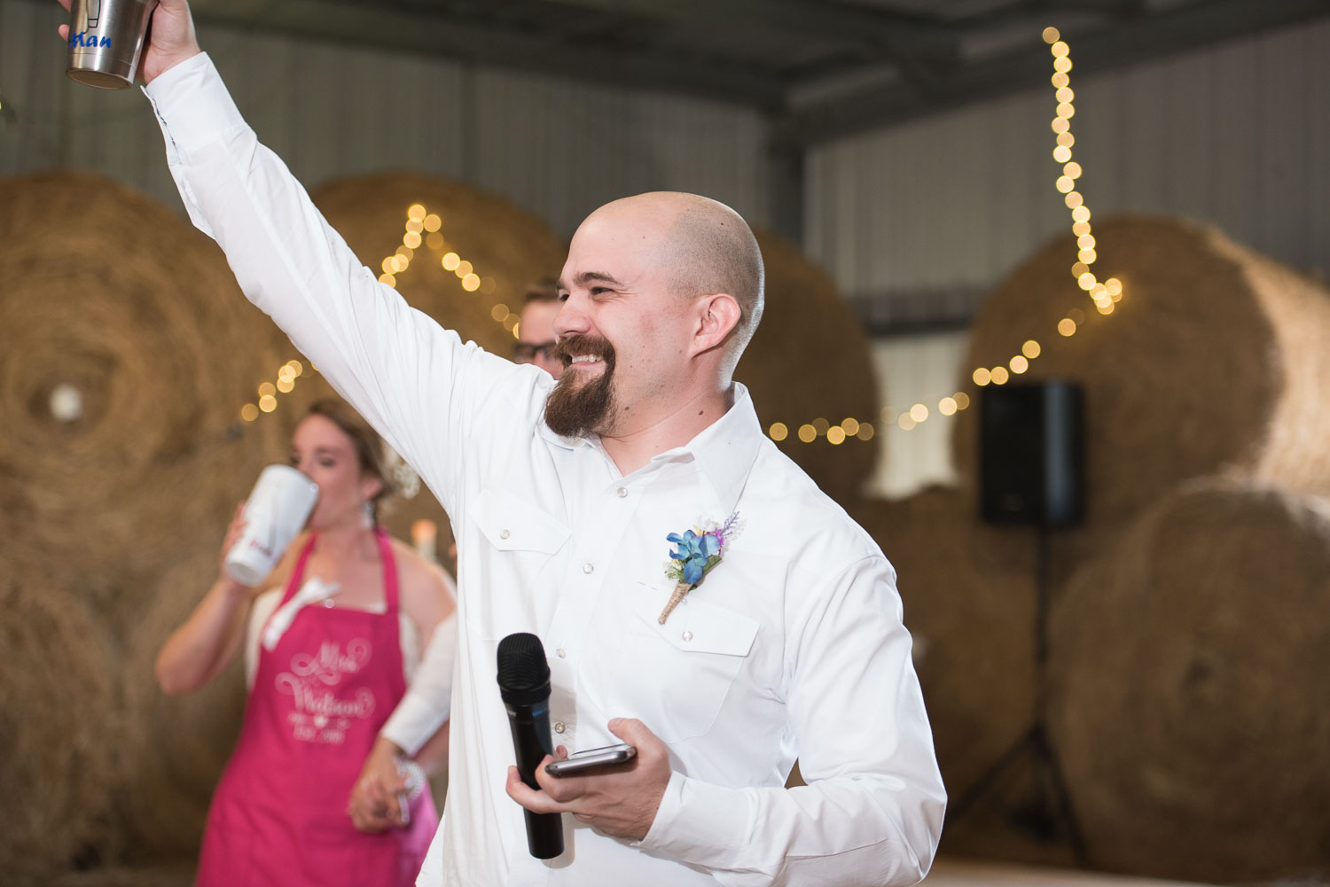 80 best man raises his glass to the new couple.jpg