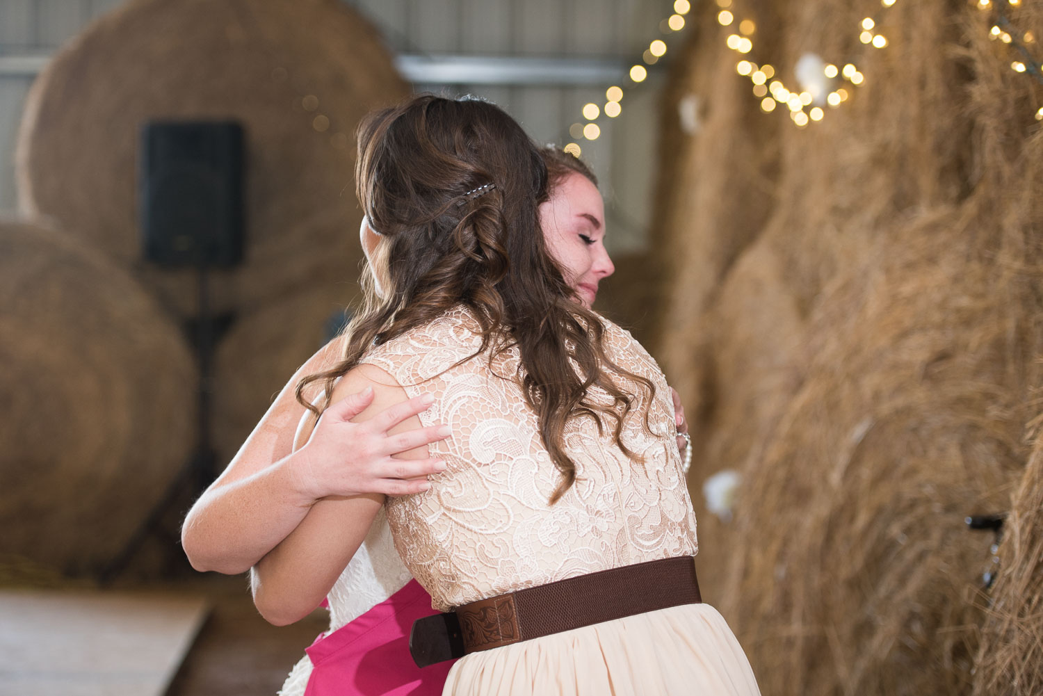 83 bride and maid of honor hug after her speech.jpg