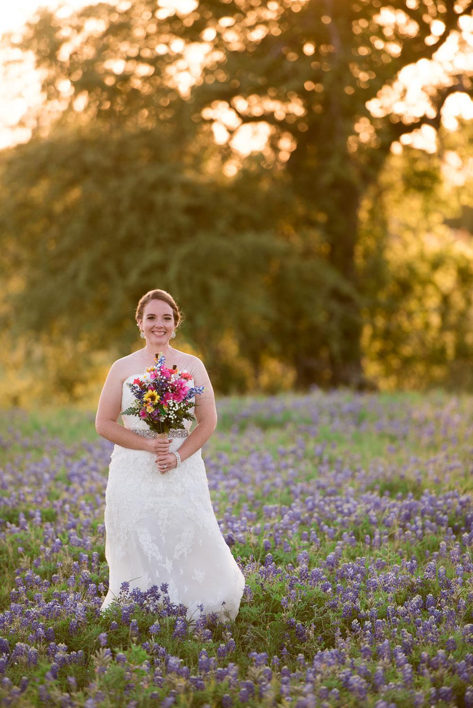 85 photos of bride in a field of bluebonnets.jpg