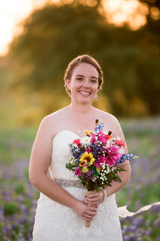 86 bridal detail with bouquet in texas farmland.jpg