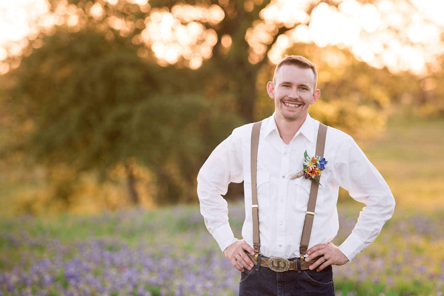 90 groom in suspenders with bouttonnier detail.jpg