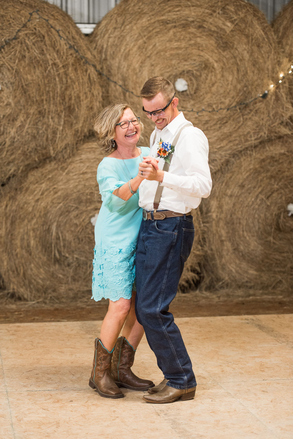 112 groom and mother of groom in boots during first dance.jpg