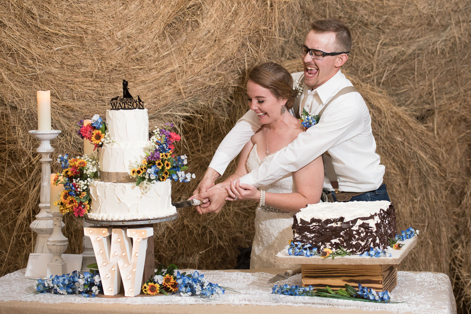 117 cutting two tier cake at wedding.jpg
