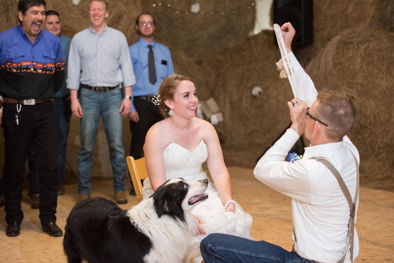124 groom throws the garter.jpg