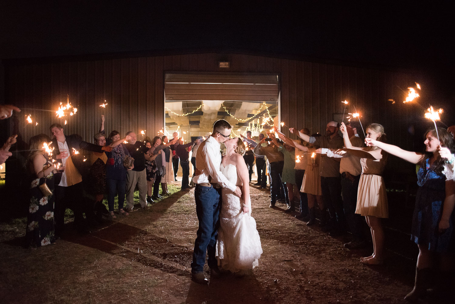 126 texas farm exit with sparklers in luling texas wedding.jpg