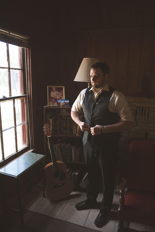 25 groom getting ready photos in texas farmhouse.jpg