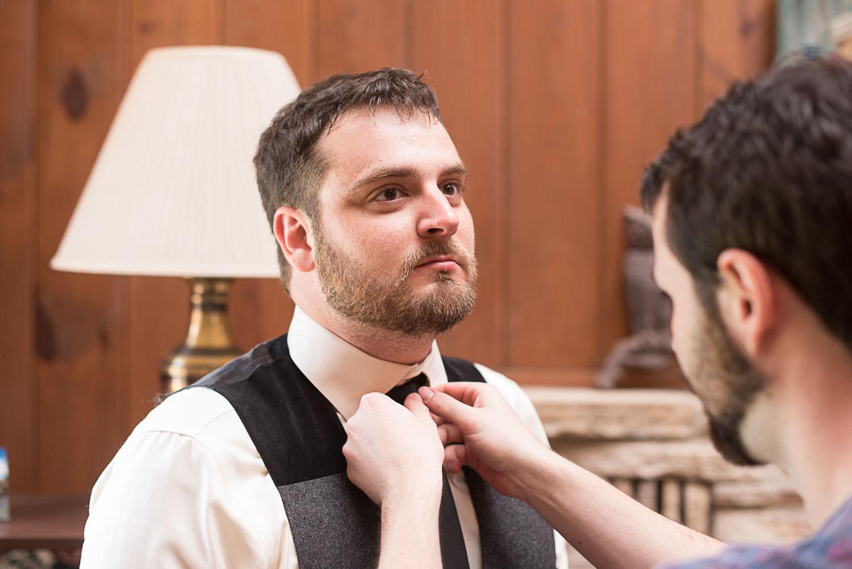 26 groom preparing for wedding.jpg