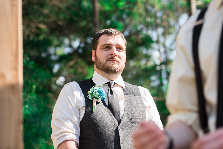 54 groom reaction of bride coming down aisle.jpg
