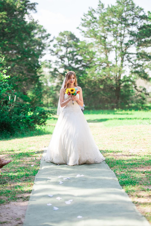 56 bride walking down aisle at austin texas wedding.jpg