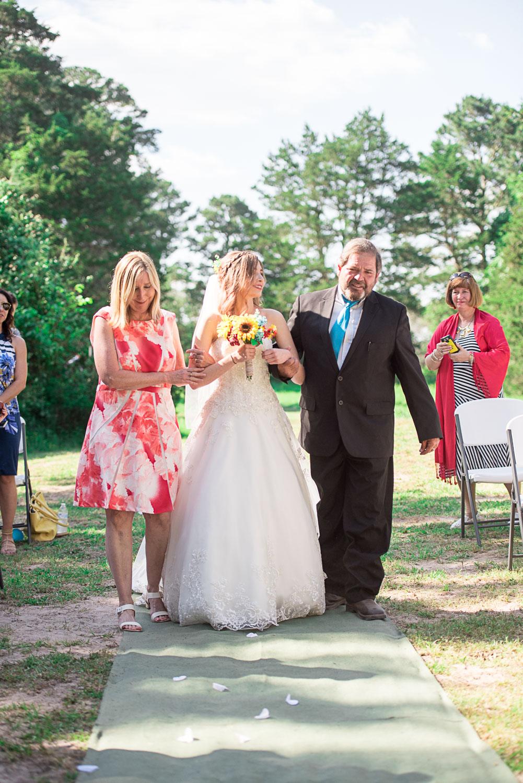 57 both parents walking bride down aisle.jpg
