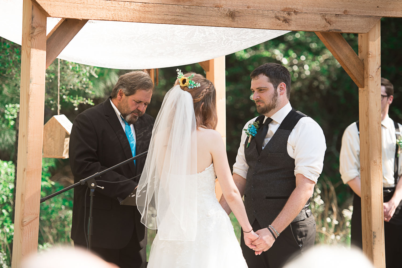 73 vow exchange at wedding ceremony.jpg