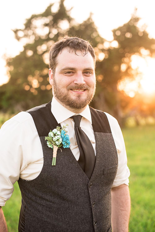 169 groom with boutteniere on.jpg