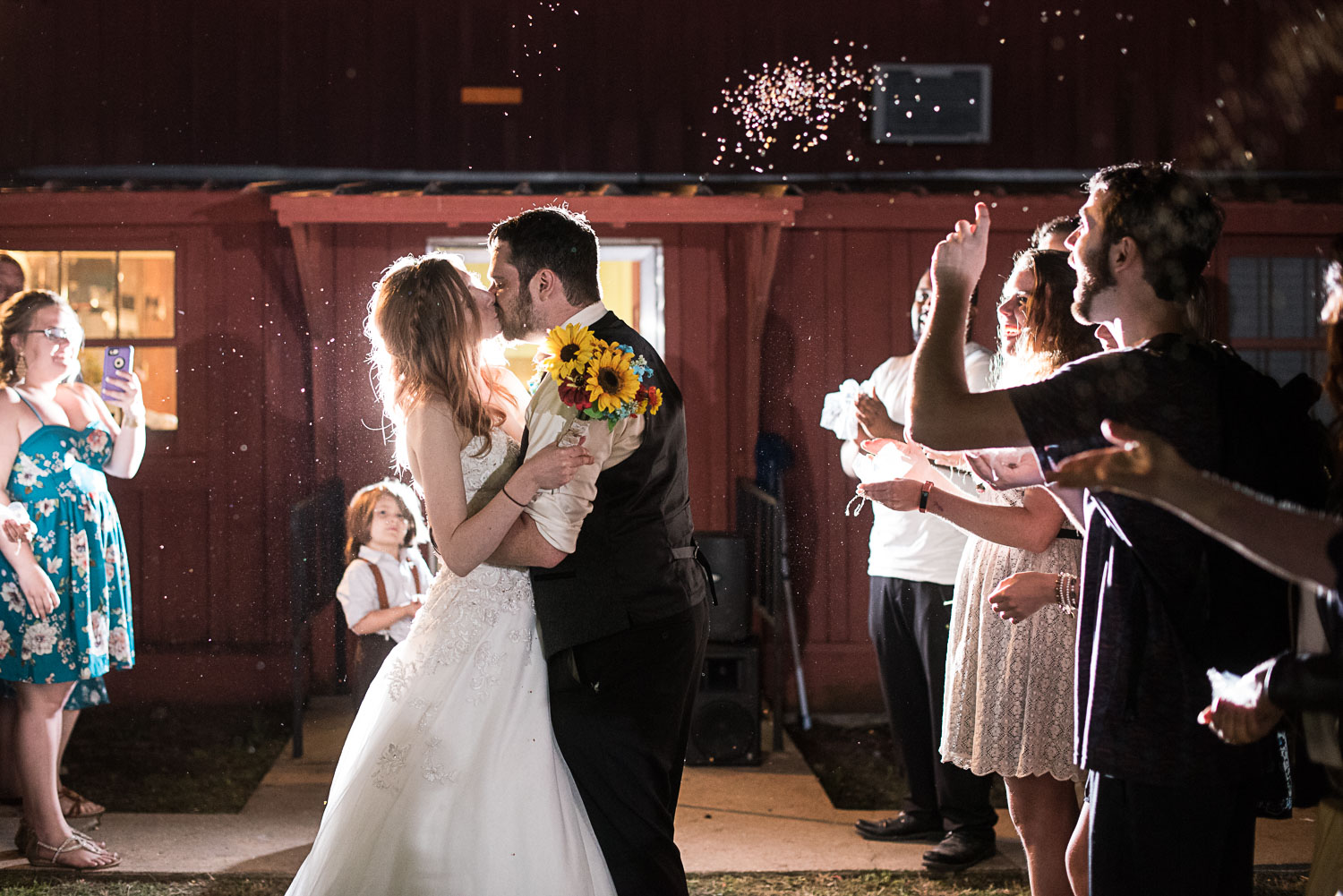 198 bride and groom exit with birdseed at night.jpg