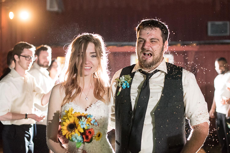 199 bride and groom birdseed exit guests.jpg