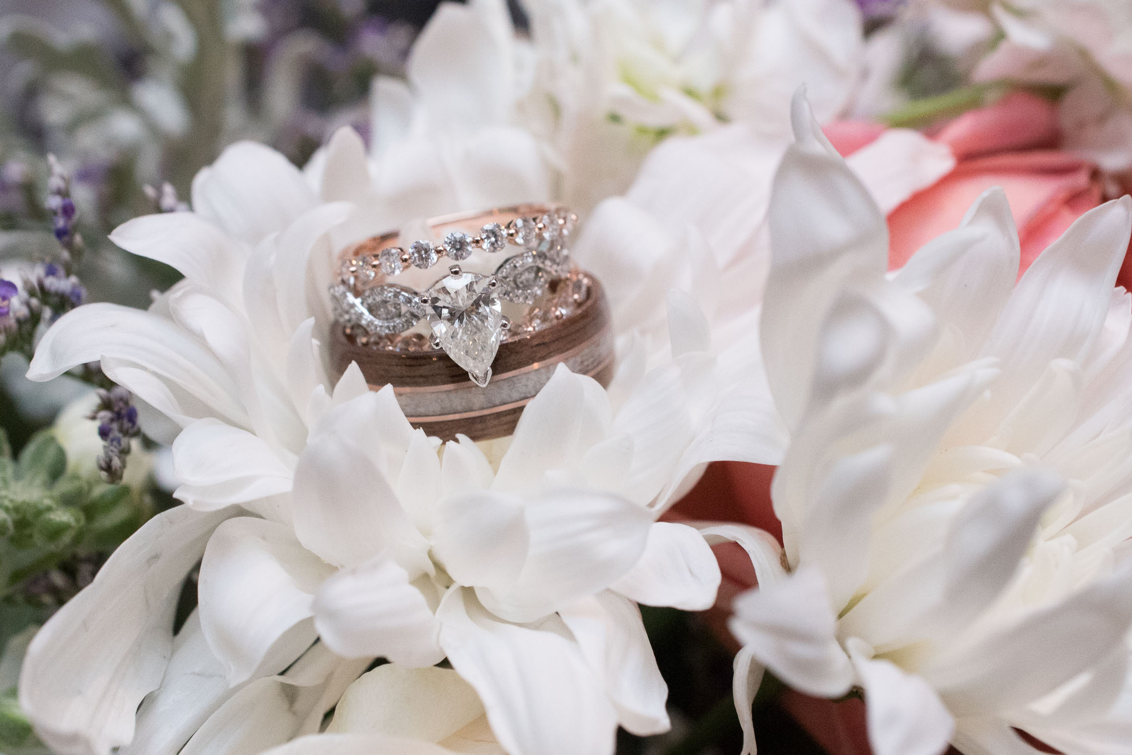 158 romantic florals with bride and groom's wedding bands.jpg