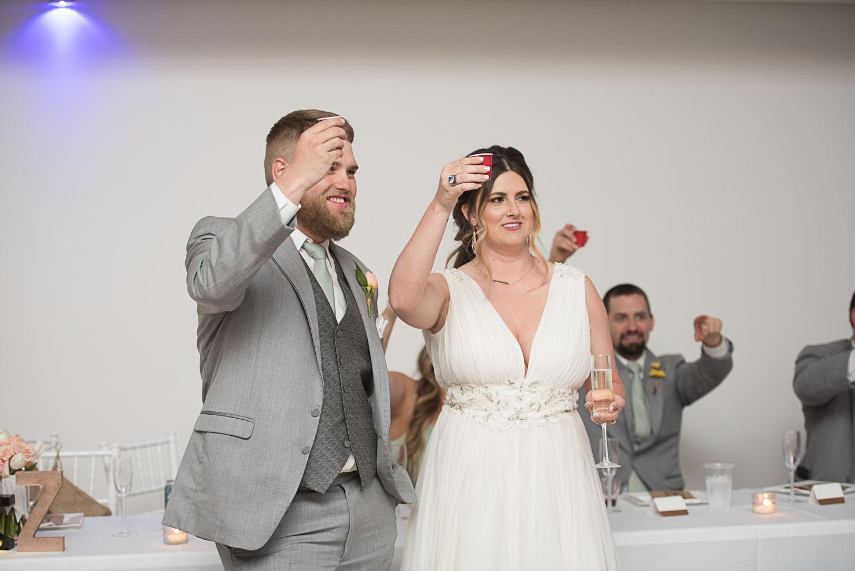 102 bride and groom toast at their wedding.jpg