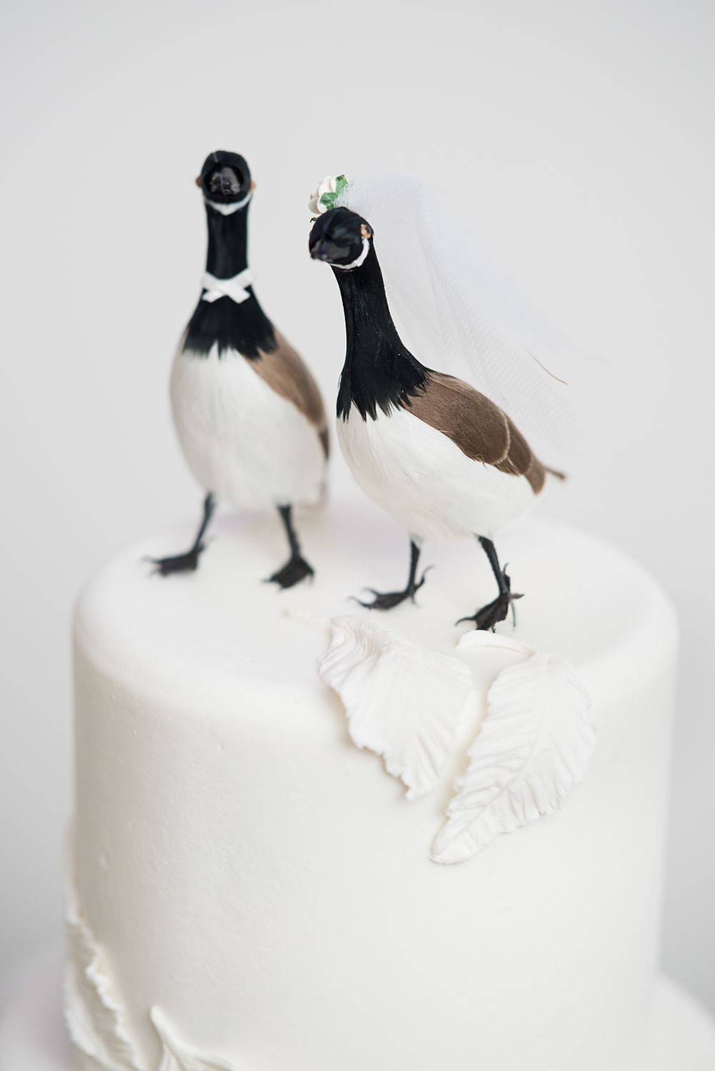 106 Cake with custom goose cake toppers.jpg