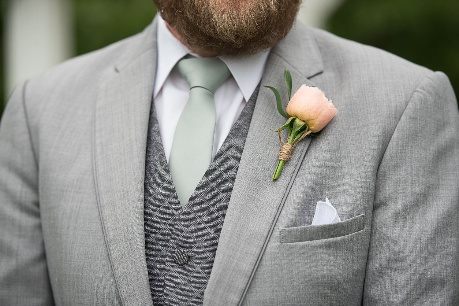 112 boutonniere with peach rose.jpg
