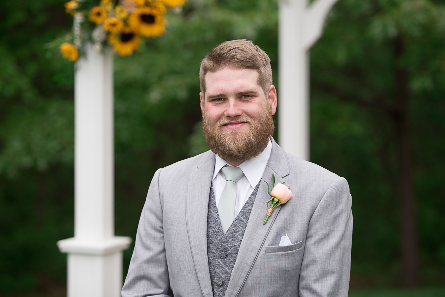 114 groom with peach rose and sunflower.jpg