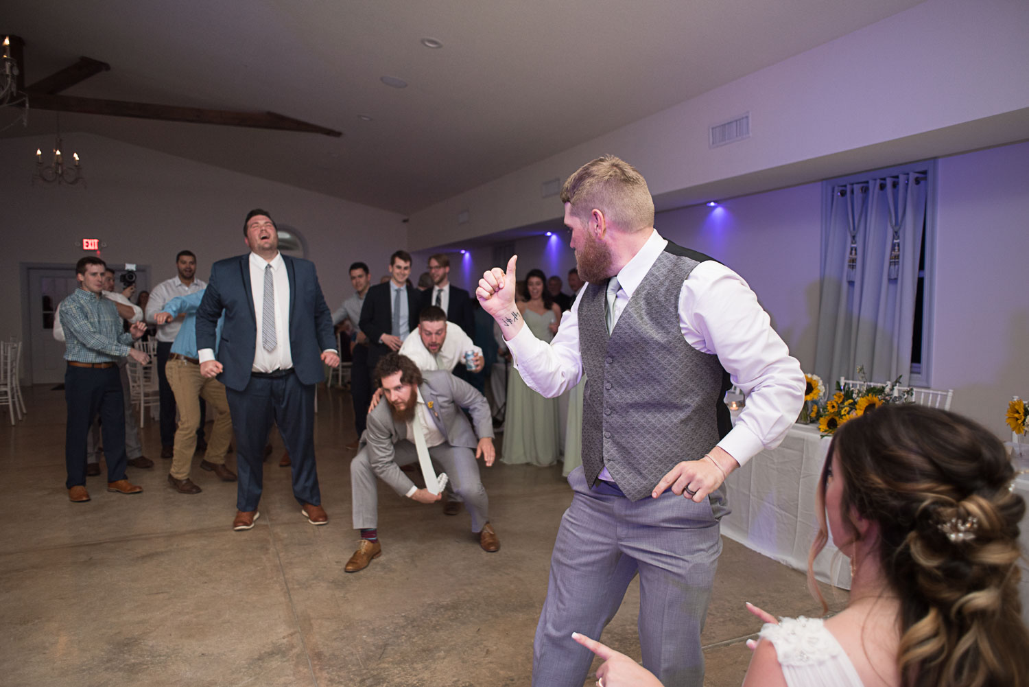 145 garter toss with groomsmen.jpg