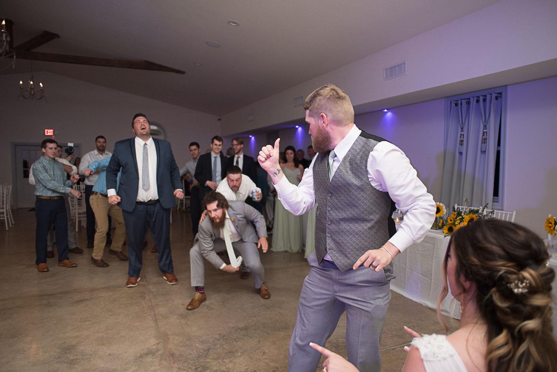 145 garter toss with groomsmen.jpg