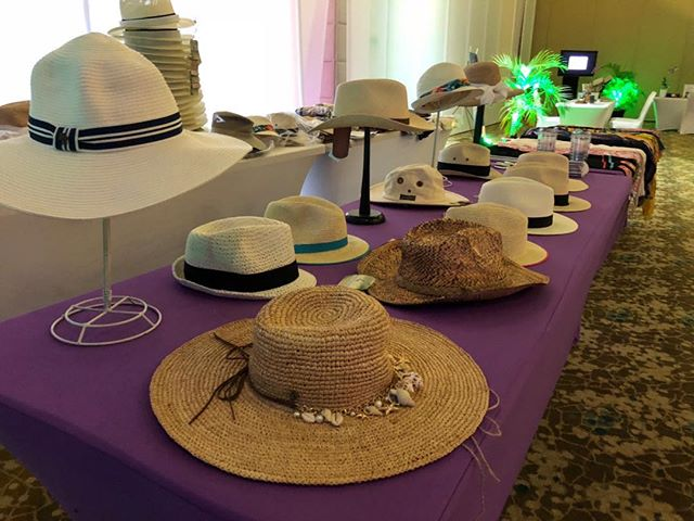 BEACH MARKETPLACE - What could be more fun, and more useful, for your guests at your tropical event this winter than a beach hat bar! We bring tons of styles onsite to give your guests options and variety..jpg