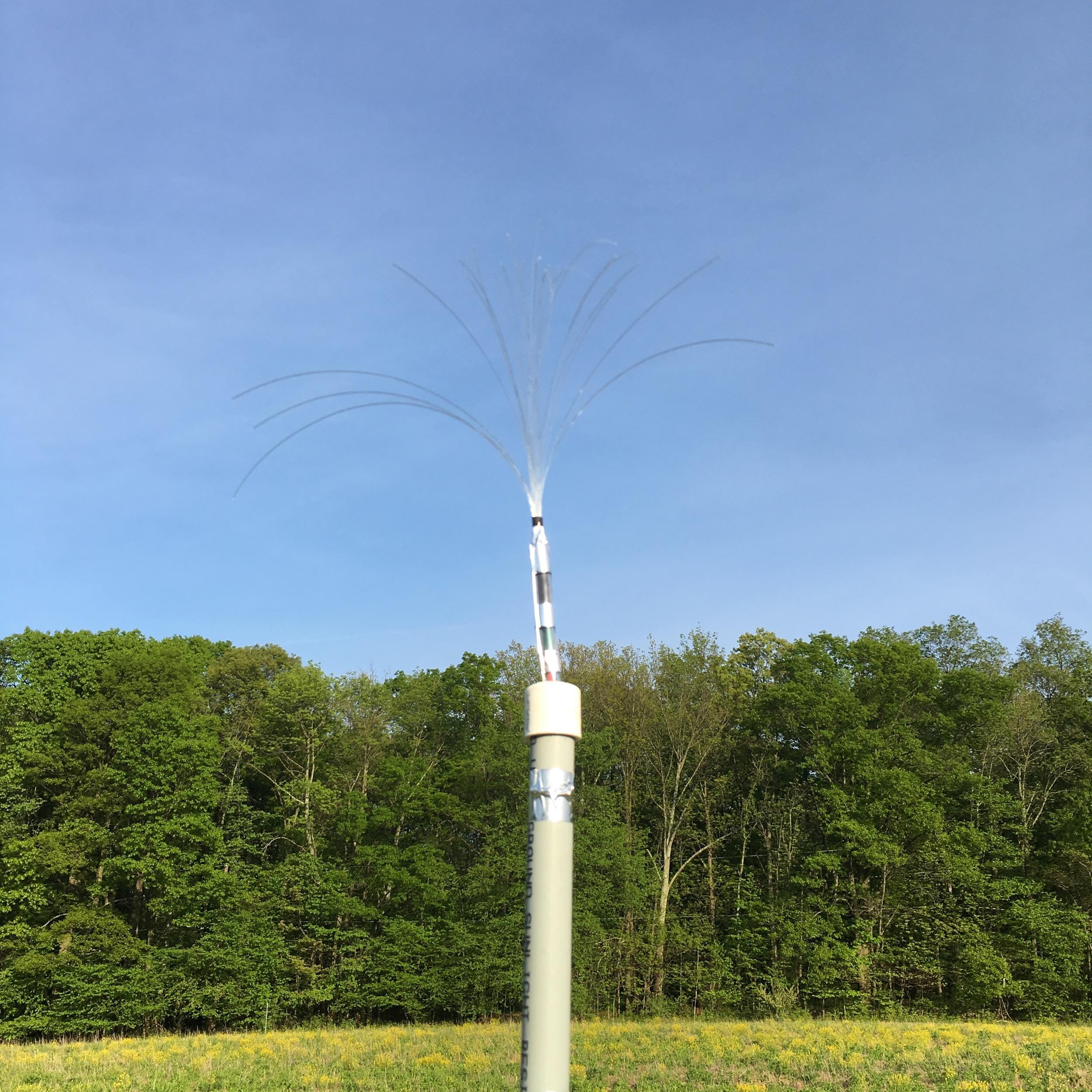 Earth-battery-powered, fiber-optic 'corn silk.'