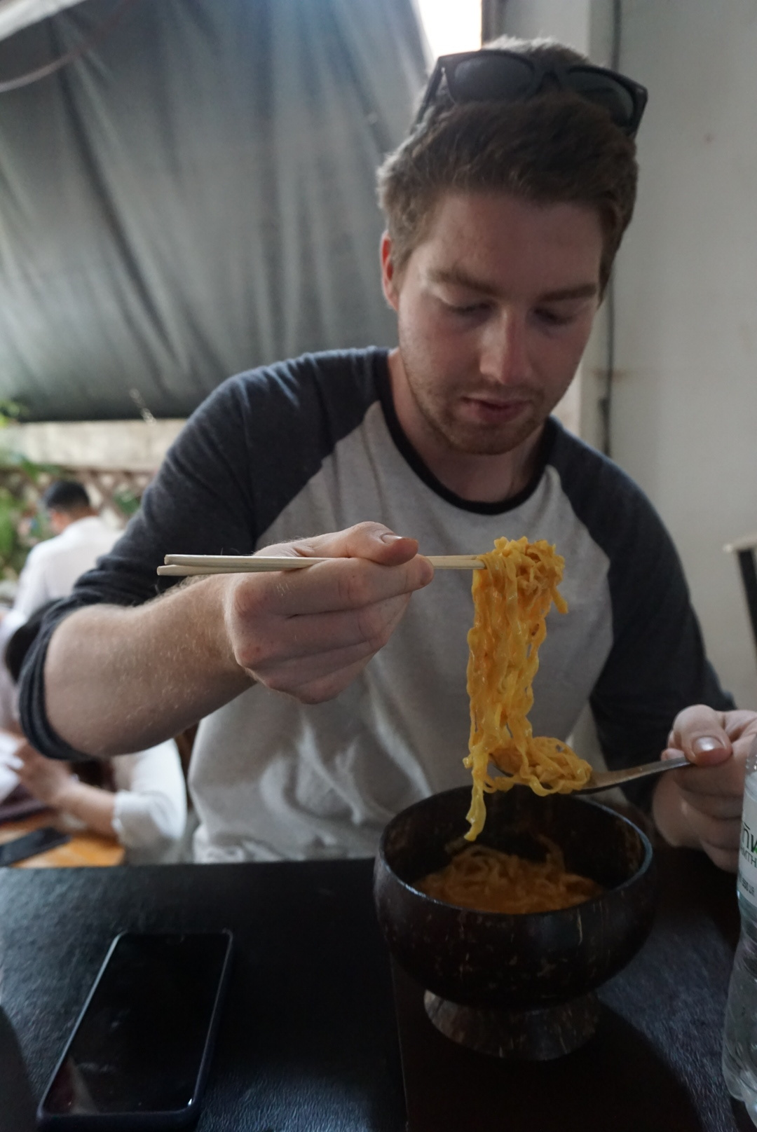 Greg loving the Khao Soi at Coconut Shell