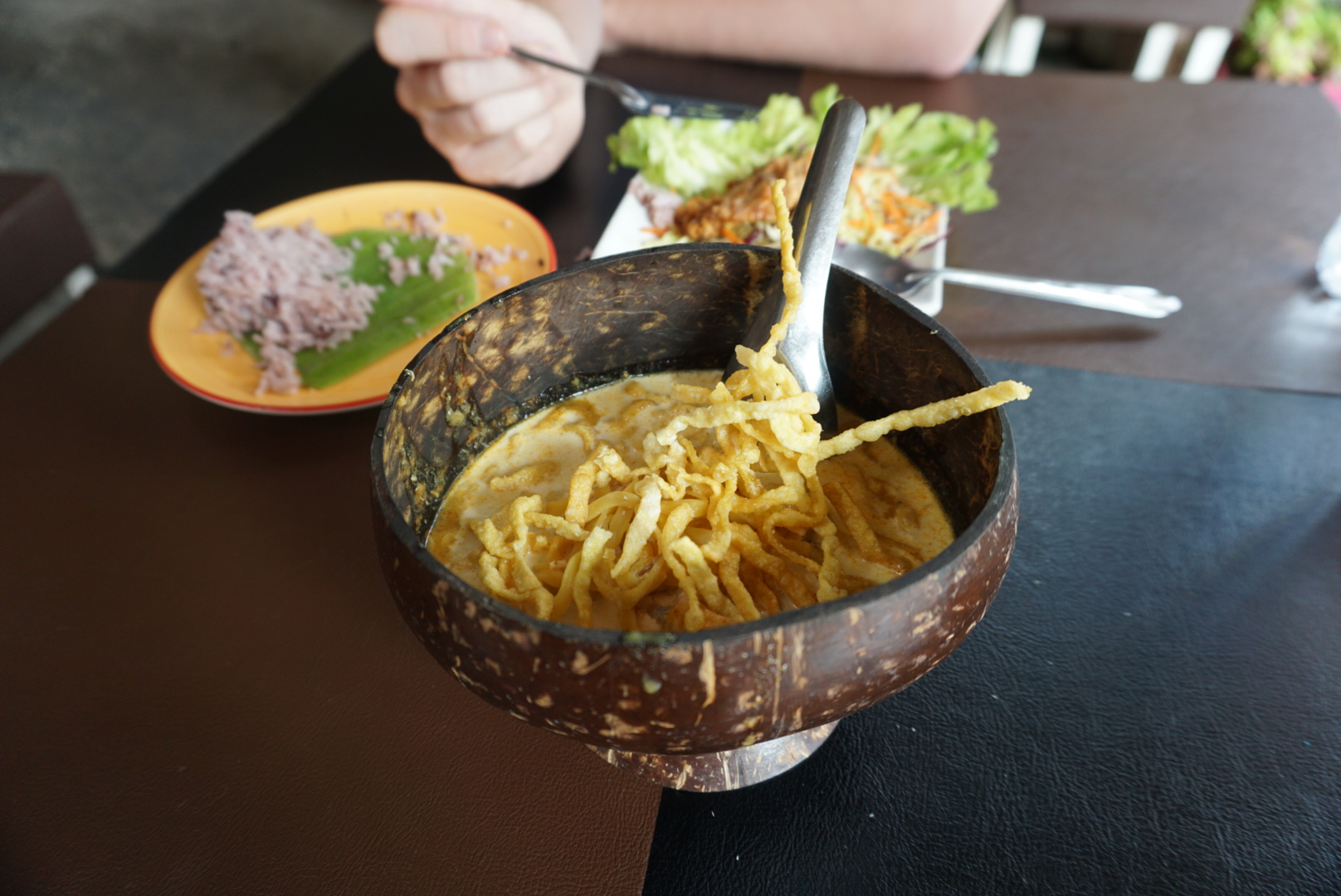 Khao Soi and stir fried chicken in garlic with rice at the Coconut Shell
