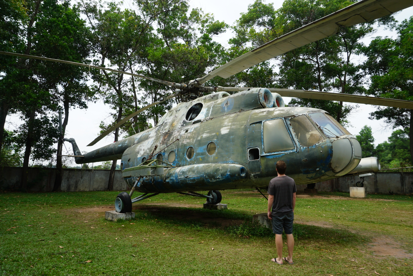 Greg looking at a Helicopter at the Cambodia War Museum.