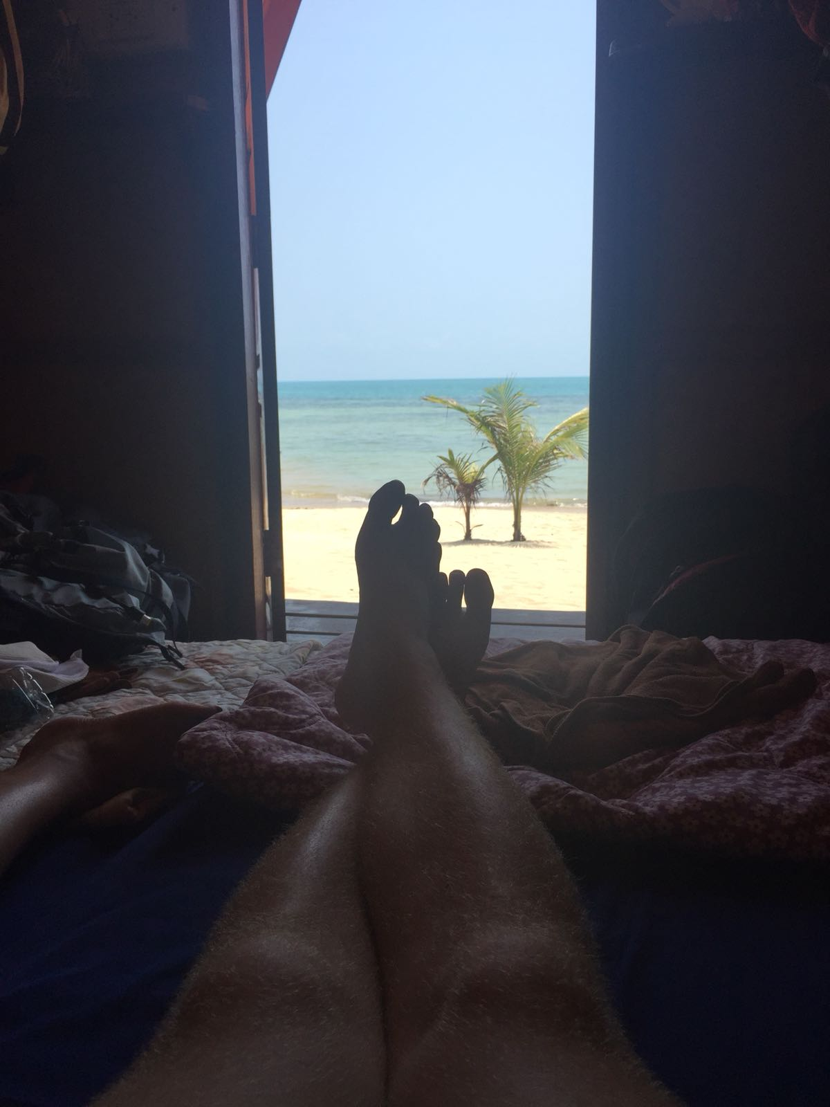 Gregs feet and the view from our beach bungalow