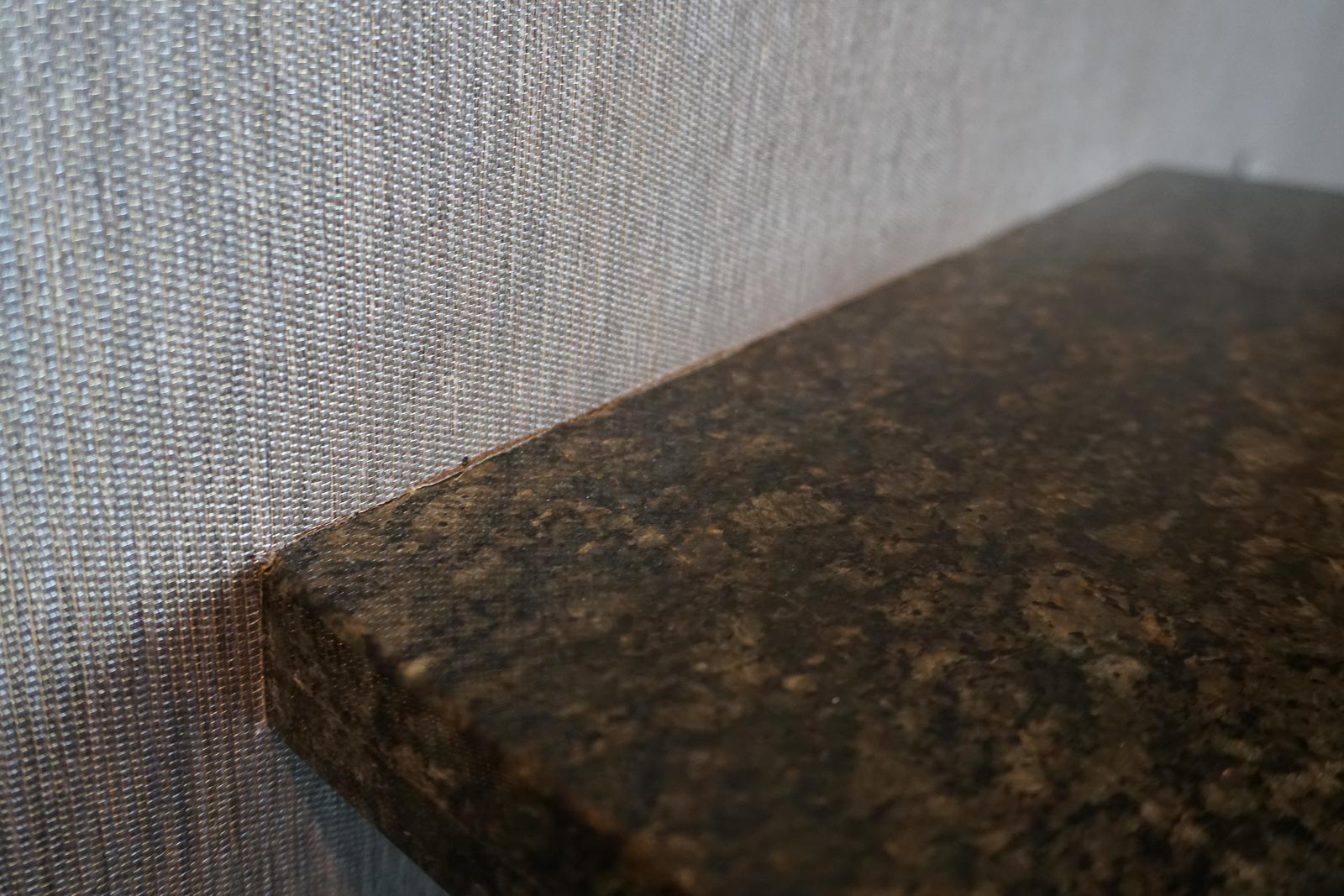 Granite meets fabric wall covering . . .