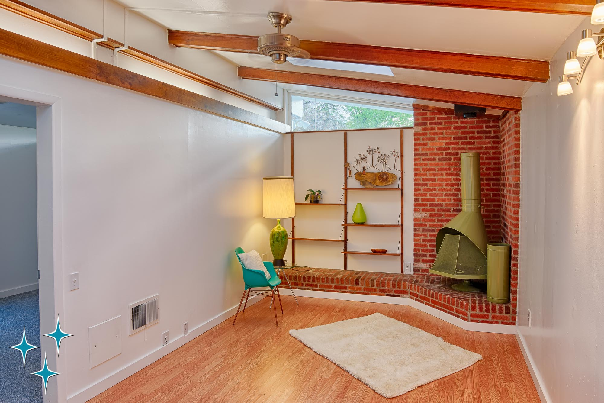 2500 S Meade Street, a Cliff May Home in Denver's Harvey Park offered by Adrian Kinney, Broker Associate, Resident Realty South Metro. A library addition with free-standing fireplace built into the original attached garage.