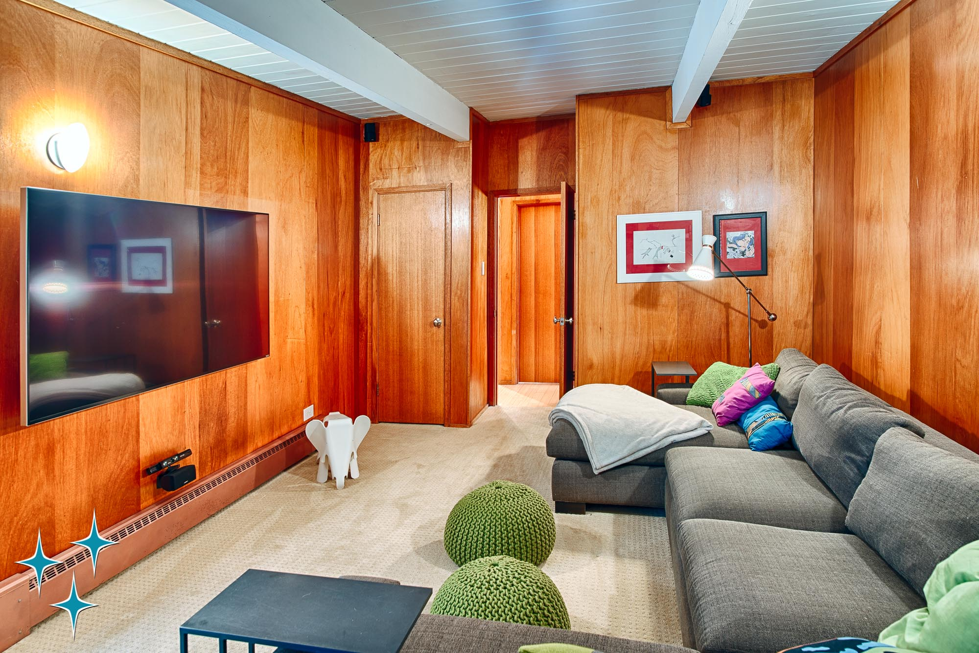 The wood-paneled media room in 4920 E Vassar Lane in Dahlia Acres, Denver. Designed by Frenchie Gratts and offered by Adrian Kinney, Broker Associate, Resident Realty South Metro