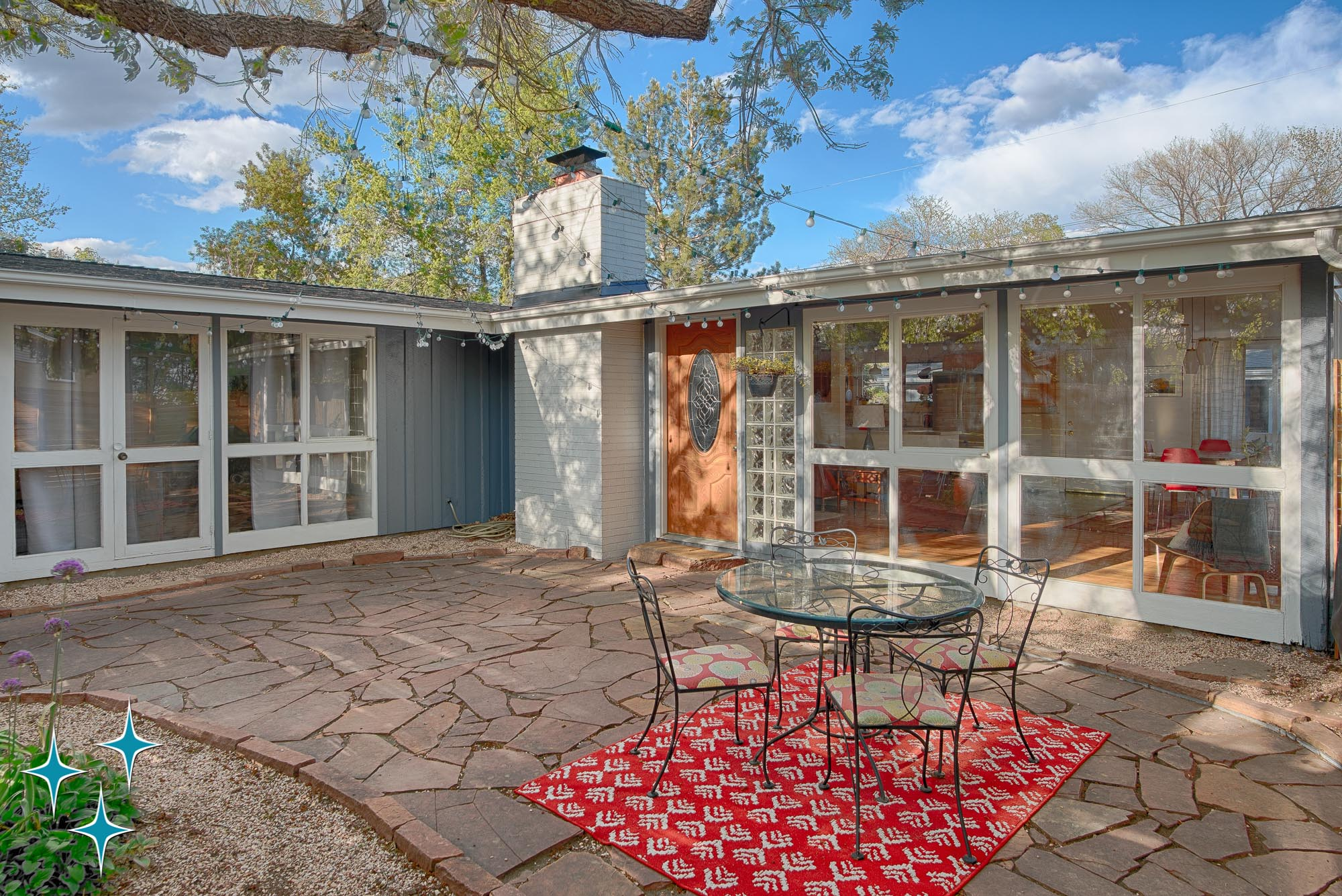 Cliff May Home at 2596 S Osceola Street in Denver's Harvey Park neighborhood. Offered by Adrian Kinney, Broker Associate, Resident Realty South Metro.