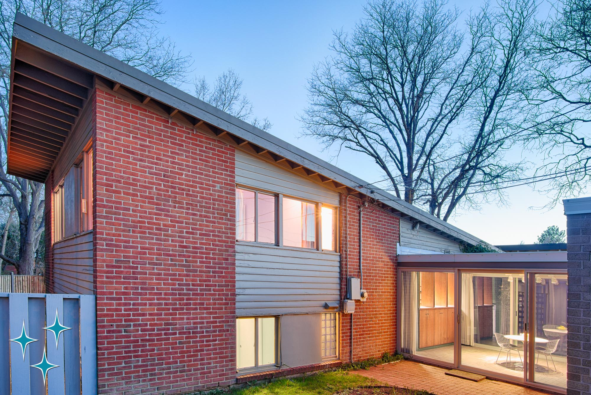2403 South Dahlia Lane, tri-level designed by Denver architect Eugene Sternberg. An ultra-modern pavilion was added behind the house after it was built. Offered by Adrian Kinney, Broker Associate, Resident Realty South Metro