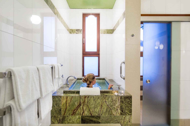An expansive bathroom features a Japanese soaking tub.