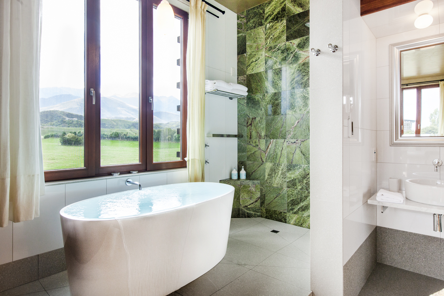 Relaxation is found in a deep, hot, soaking tub with a great view.