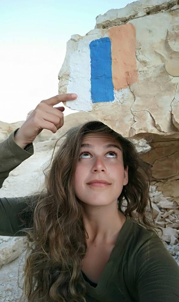 Fellow hiker Denise Stolnik pointing to the beloved trail marker of the Shvil Yisrael