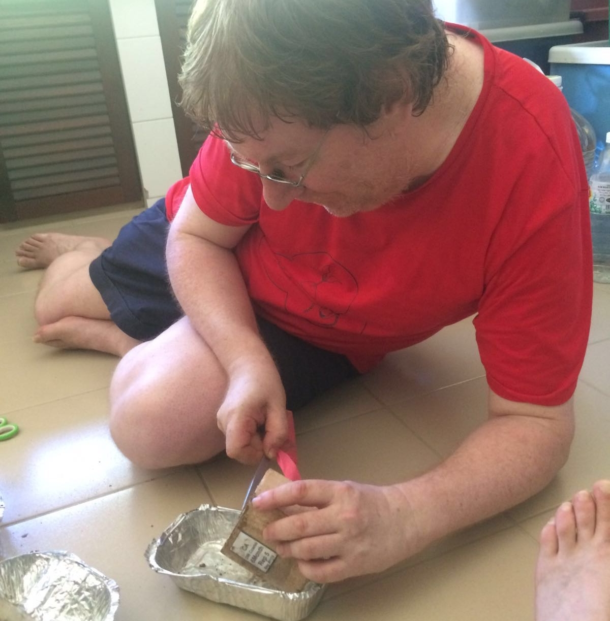 Paul checks a wood block for termites